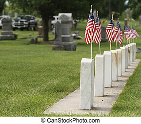 American flags with tombstones