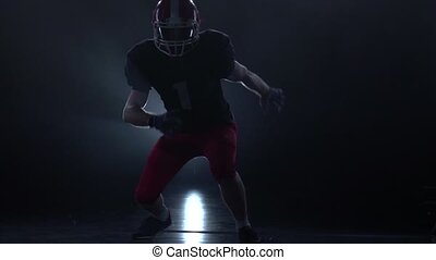 American football. Accelerate before the attack in slow motion