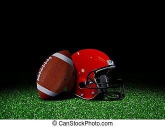 American football and helmet on fie