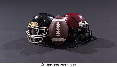 american football and helmets isolated on gray