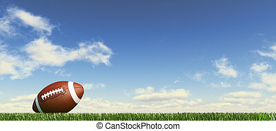 American football ball, on the grass, with fluffy couds sky...