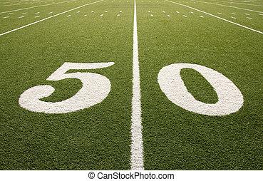 Closeup of 50 yard line on American football field.