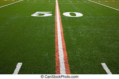 American Football Field - 50 yard line - The 50 yard line of...