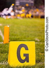 American football goal marker with blurred team