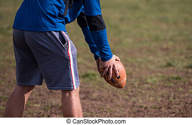 american football kicker practicing kickoff