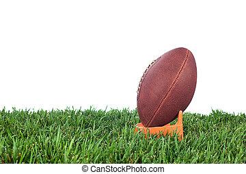 American football kickoff - Football tee on green grass...