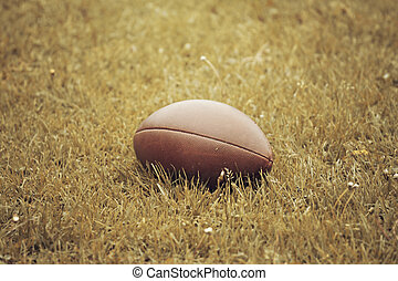 American Football lying on the field