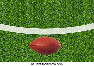 American football on green grass