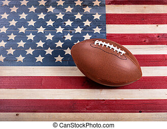 American football on rustic wooden USA flag