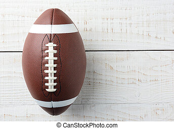 American Football on White Wood Table