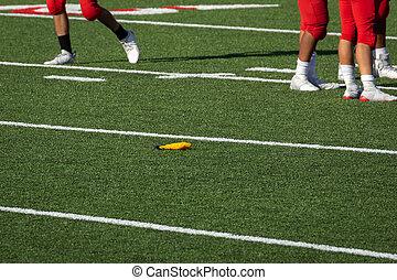 American Football Penalty Flag thrown on field