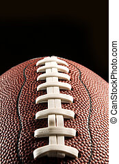 American football against black background