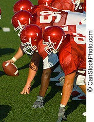 American Football played by young men, the offensive line...