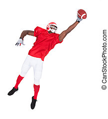 American Football Player Catching Rugby Ball - Portrait Of...