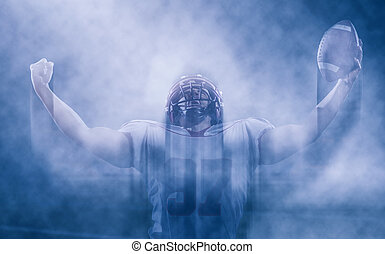 american football player celebrating after scoring a...