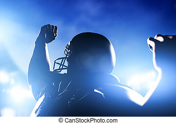 American football player celebrating score and victory.