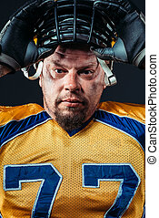 American football player face, helmet on the head