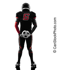 american football player holding soccer ball  silhouette