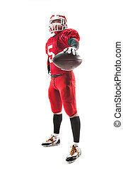 American football player posing with ball on white background