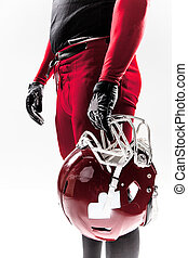 American football player posing with helmet on white background
