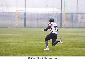 American football player running on the field