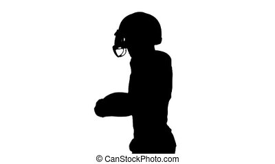 American football player running with the ball and throws it. Slow motion