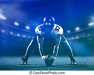 American football player starting football game on american...