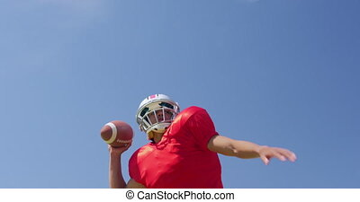 American football player throwing a ball - Low angle front ...