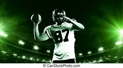 american football player throwing rugby ball