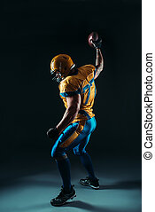 American football player with ball in hand, NFL