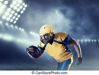 American football player with ball on sport arena
