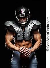 American football player with ball wearing helmet and...