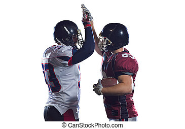 american football players celebrating after scoring a touchdown