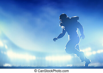 American football players in game, running. Stadium lights...