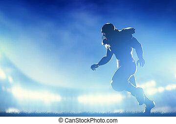 American football players in game, running. Stadium lights...
