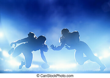 American football players in game, touchdown. Stadium lights...