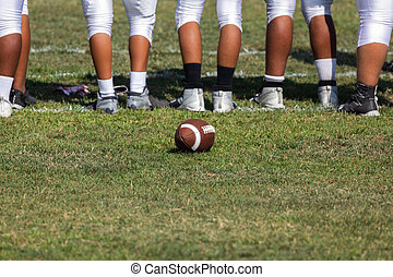 American Football Players Standing on Sideline