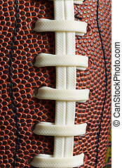 American Football - Macro shot of the laces on a Brown...