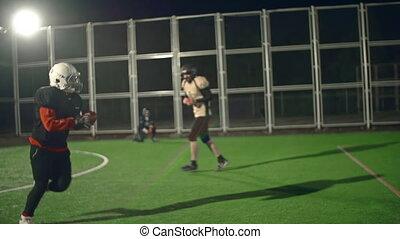 American Football - Slow motion of quarterback scoring to...