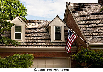 American Gables - American Flag Hanging over Wood Shingles...