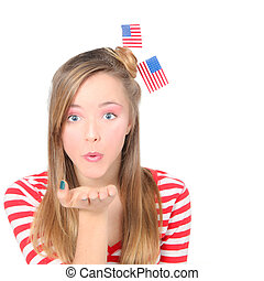 AMERICAN GIRL BLOWING WISHES OR KISSES CELEBRATING 4TH OF JULY WITH FLAGS