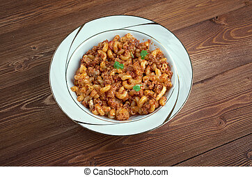 American goulash - dish baked as a casserole american pasta, beef as tomato sauce.