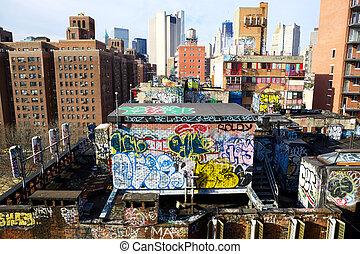 American Graffiti - Graffiti atop buildings in China Town in...