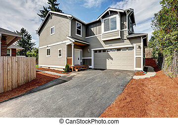 American gray house exterior with garage and driveway