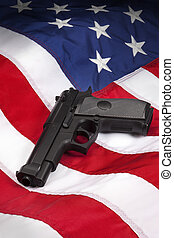American Gun Laws - American Gun Law - Hand Gun on the flag ...