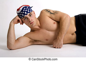 American guy - Barechested, muscular man wearing a do=rag