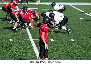 American high school football player getting ready to go out for a pass.