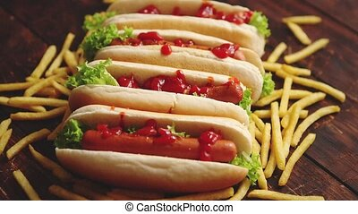 American hot dogs assorted in row. Served with french fries....