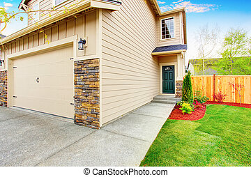 American house exterior with beige trim, garage with concrete driveway