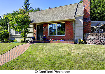 American house exterior with brick and clapboard siding trim